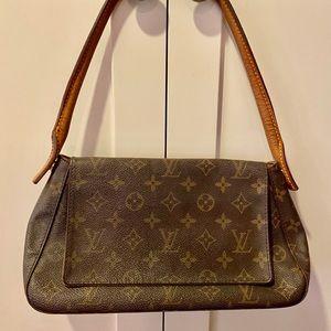 Fantastic Louis Vuitton Mini Looping handbag!